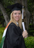 Master's Degree Woman. A photo of a young woman who has just received her master's degree royalty free stock photography