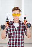 Master with screwdriver and drill Stock Image