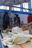 Master sewing sails. stock image