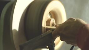 Master sharpening on a lathe wood. Master slowly carving chisel candlestick on a lathe stock video footage