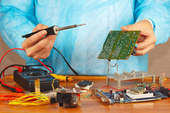 Master solder electronic board of device in service workshop Royalty Free Stock Images