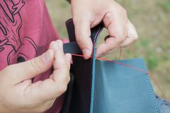 Sewing the edge of a leather bag