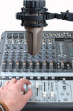 Master studio of the sound producer. Nice studio microphone in front of an audio mixer Royalty Free Stock Photo