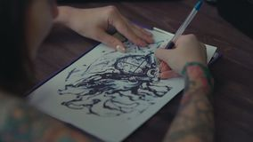 Master tattoo transfers pattern on tracing paper by pencil. stock video footage