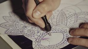 Master tattoo transfers pattern on tracing paper. Sketch future tattoos. stock video footage