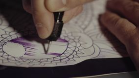 Master tattoo transfers pattern on tracing paper. Sketch future tattoos. stock footage