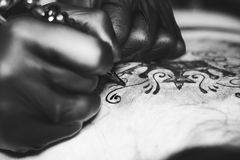 Master tattoo woman on her back. Tattooer showing process of making a tattoo hands holding a tatoo machine stock photography