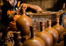 Master of terracoota. Master hands on terracotta pottery doing handmade water pot Royalty Free Stock Photo