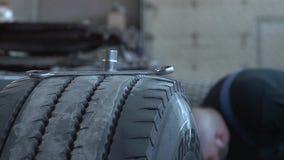 Master truck repairs stock video