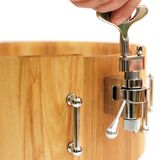 Master tuning new wooden snare drum isolated closeup Royalty Free Stock Photo