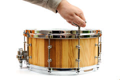 Master tuning new wooden snare drum isolated Stock Image