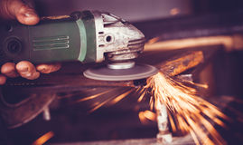 Master of welding seams angle grinder Royalty Free Stock Photos