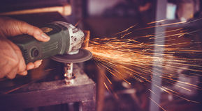 Master of welding seams angle grinder Stock Photo