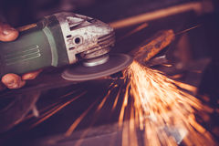 Master of welding seams angle grinder Stock Image