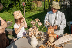 Master of wooden products with granddaughter Royalty Free Stock Images
