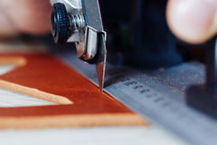 Master of work with leather goods Stock Photography