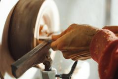 Master working on a lathe on wood acceleration Royalty Free Stock Photos