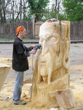 Master works above creation of wooden sculpture Stock Photos