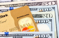 MasterCard Credit Card with US dollar bills Royalty Free Stock Photography