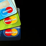 Mastercard credit cards. Collection of Mastercard credit cards, including Maestro electronic card, isolated on black background Stock Photography