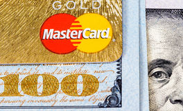 Mastercard Debit Card with US dollar bills Royalty Free Stock Photography