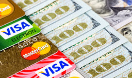 Mastercard Debit Card, Visa with US Dollar bills Royalty Free Stock Photos