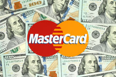 Mastercard logo printed on paper. Kiev, Ukraine - June 13, 2016: Mastercard logo printed on paper and placed on money background. MasterCard Worldwide is an Stock Image