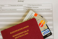 Mastercard and visa card on a german passport application form Stock Images