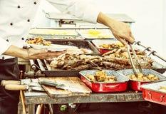 Masterchef供食烤肉,黄色照片过滤器 库存图片