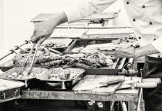 Masterchef serves grilled meat, detail food and hands scene, col Royalty Free Stock Images