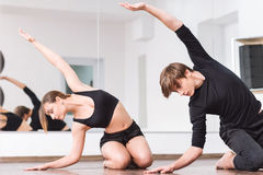 Masterful dance partners warming up royalty free stock photography