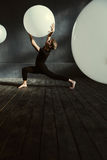 Masterful dancer performing in the dark lighted room Stock Image