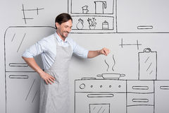 Masterful experienced cook salting the dish royalty free stock images