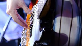 Masterful, masterly game on an electroguitar. Man plays a close up of a hand on an electroguitar royalty free stock image