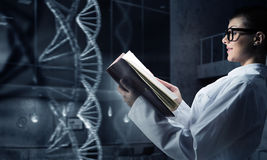 She is mastering the science . Mixed media Royalty Free Stock Photography