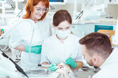 Mastering their skills of future dentists royalty free stock image
