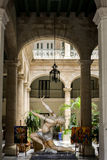 Masterpiece. Havana's old hotel courtyard with woman figure, Cuba royalty free stock photo