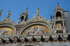San Marco church dome facade. Masterpiece mosaic white and colorful facade with golden paint of Basilica di San Marco Saint Mark`s Basilica  in Venice, Italy Royalty Free Stock Image