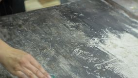 Masters in the art studio process the wood with paint and putty, achieve the aging effect. Masters in the art studio process the wood with paint and putty stock footage