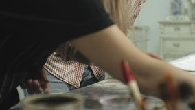 Masters in the art studio process the wood with paint and putty, achieve the aging effect. Masters in the art studio process the wood with paint and putty stock video