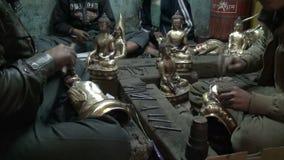 Masters group  make copper bronze Buddha statue souvenirs in Kathmandu, Nepal stock footage