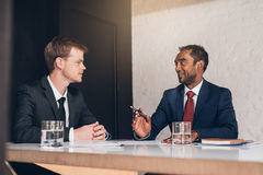 Masters of negotiating at work in the boardroom Stock Image