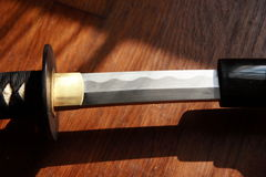Masterwork Katana. On a wooden floor Royalty Free Stock Photo