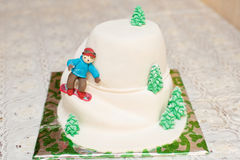 Mastic cake in mountain form with skier. Closeup Royalty Free Stock Photo