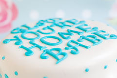 Mastic letters on birthday cake Royalty Free Stock Photo