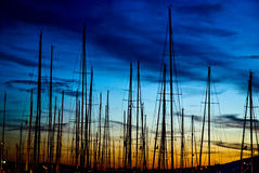 Masts against the sunset sky Royalty Free Stock Photography