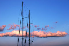 Masts against the sunset sky Royalty Free Stock Photo