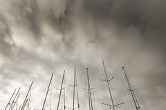 Masts against winter skies. In Mallorca, Balearic islands, Spain on a sunny afternoon in December, monochrome sepia Royalty Free Stock Photography