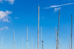 Masts of Boats. Boat masts against a blue sky royalty free stock image