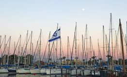 Masts of boats in Marina for yachts. At sunset and moon stock photo